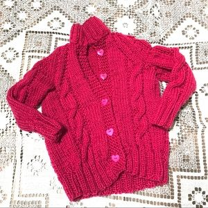 Handmade pink knit sweater with heart buttons
